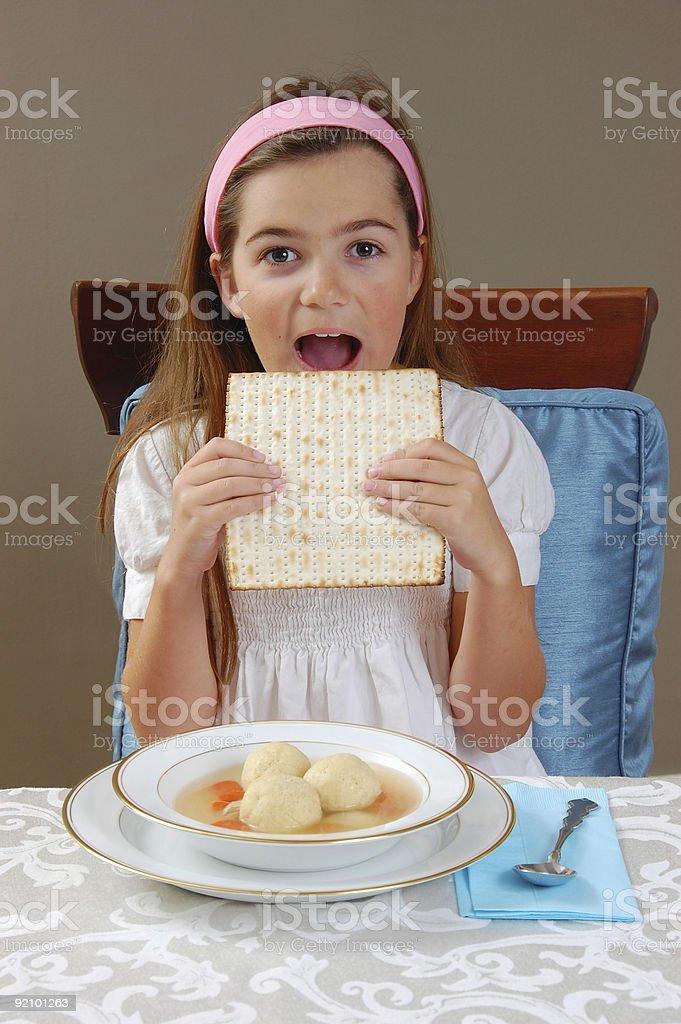 Eating Matzah stock photo