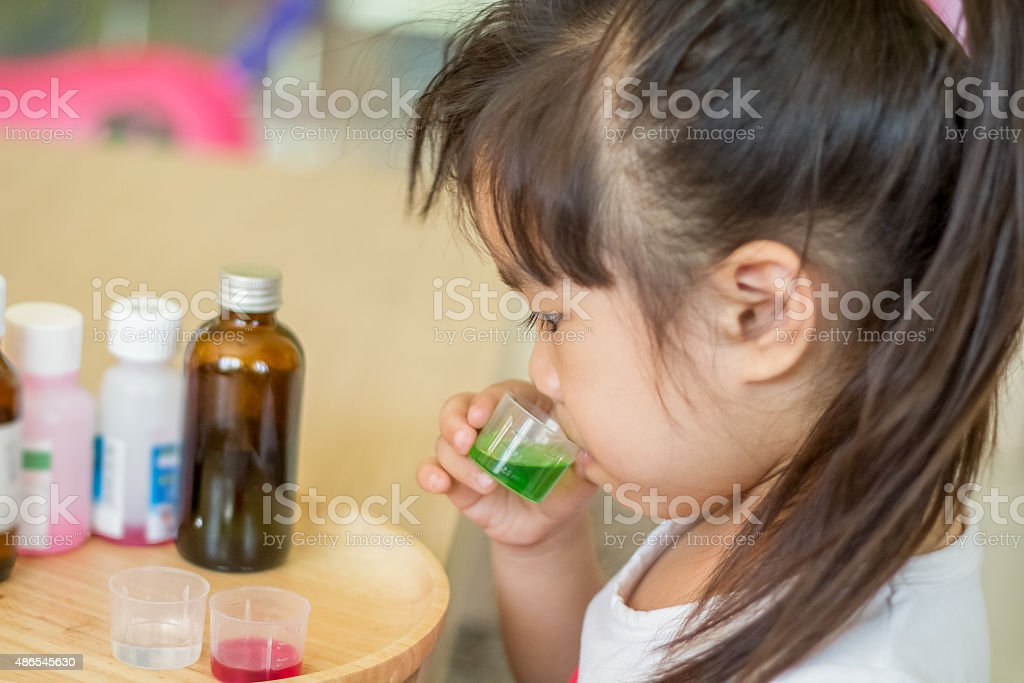 Eating medicine for Illness child stock photo