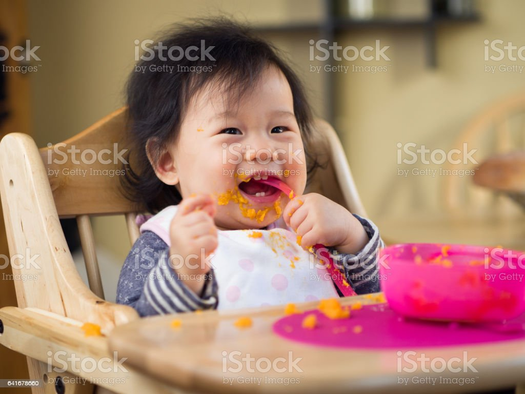 eating mess baby girl stock photo