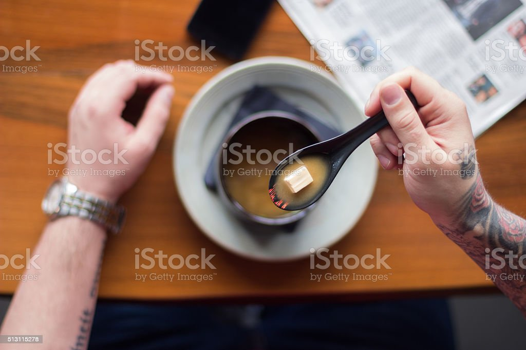 Eating miso soup stock photo