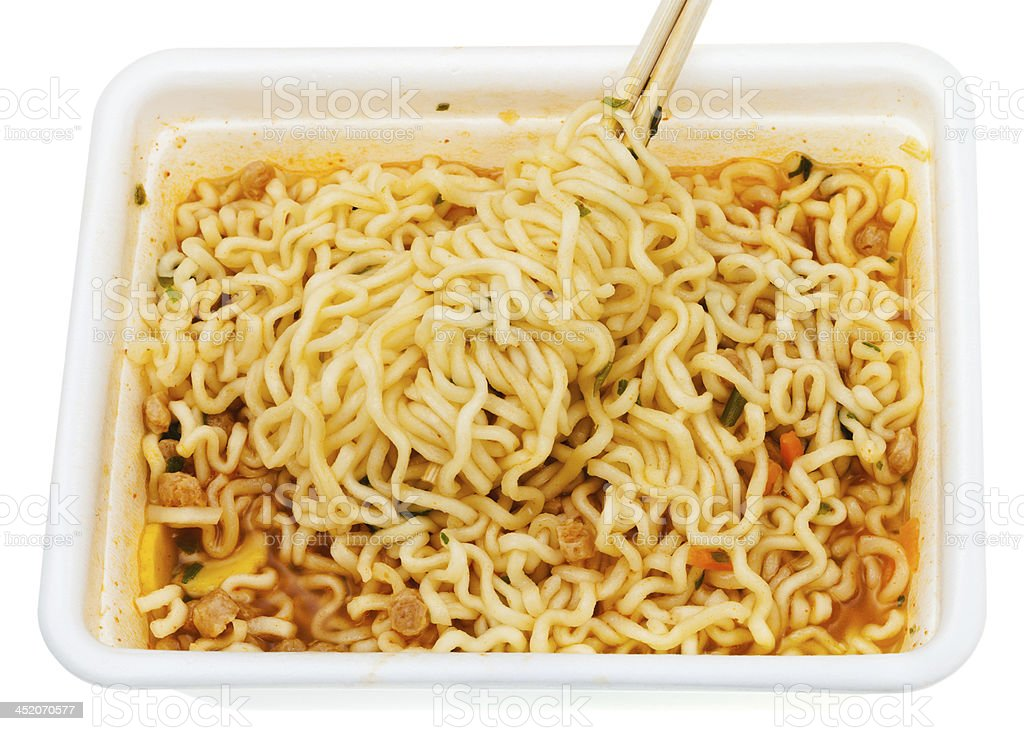 eating of instant noodles from lunch box royalty-free stock photo