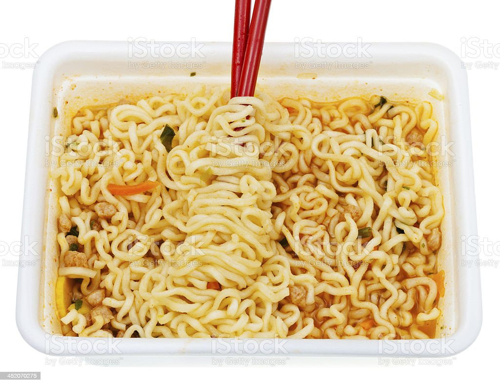 eating of instant ramen from lunch box royalty-free stock photo