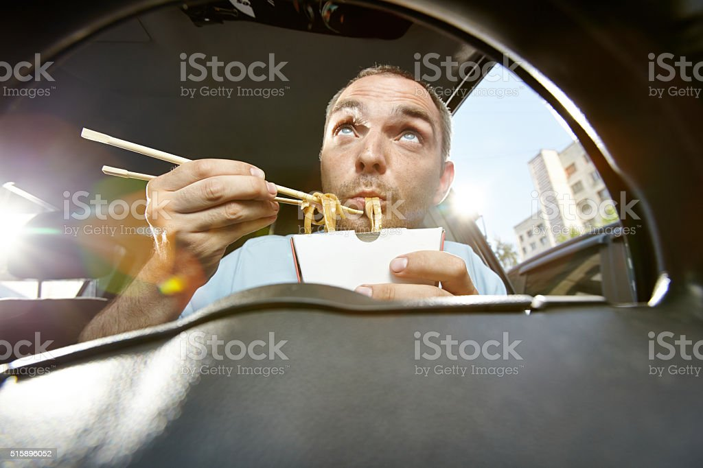Eating on the move stock photo