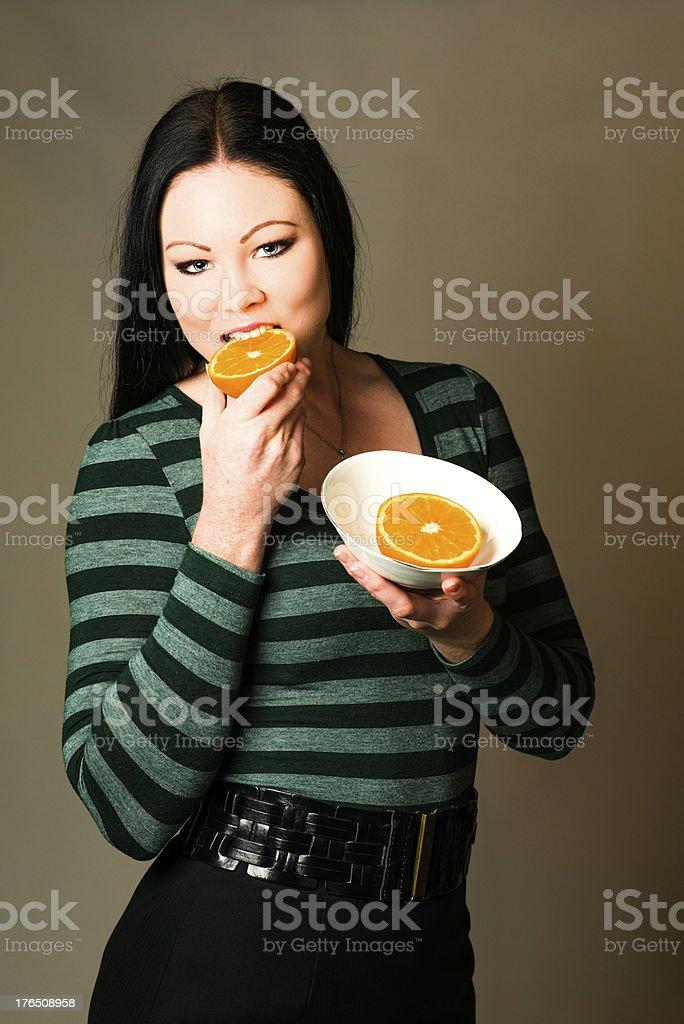 Eating orange royalty-free stock photo