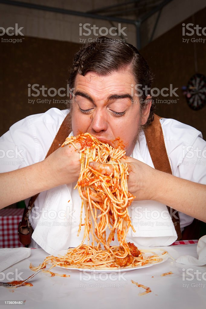 Eating Pasta with hands royalty-free stock photo