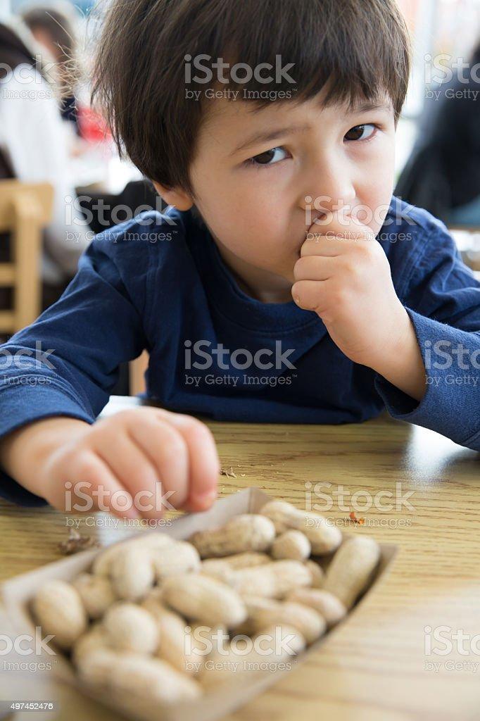 Eating Peanuts stock photo