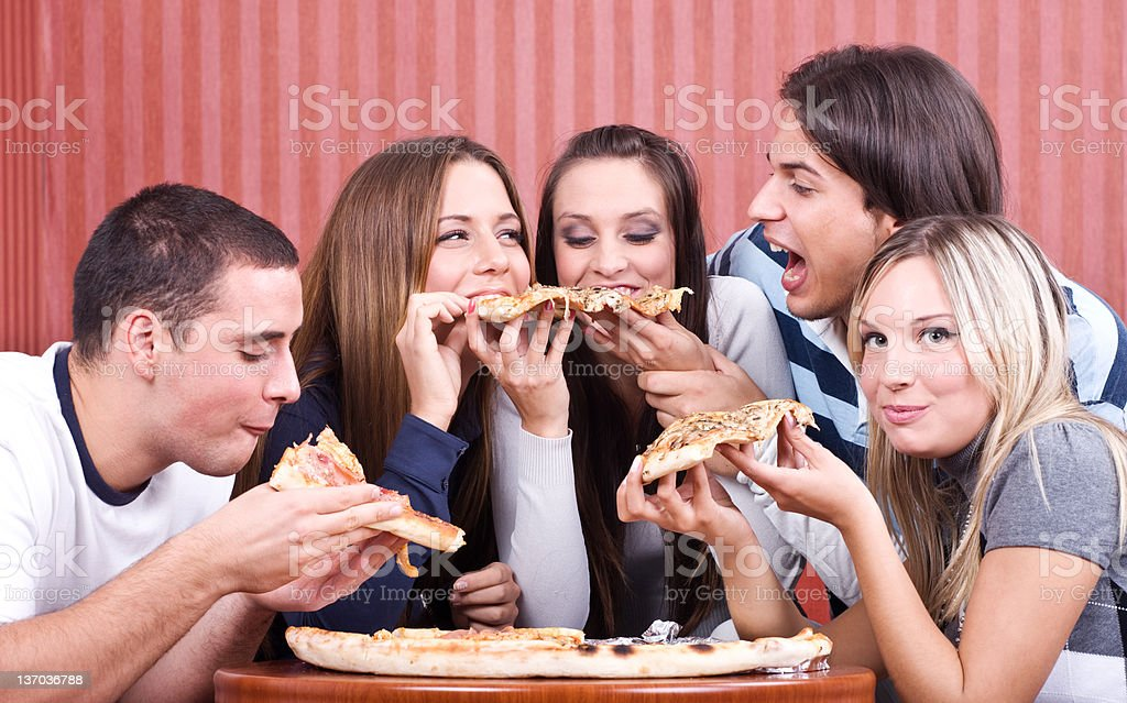eating pizza royalty-free stock photo