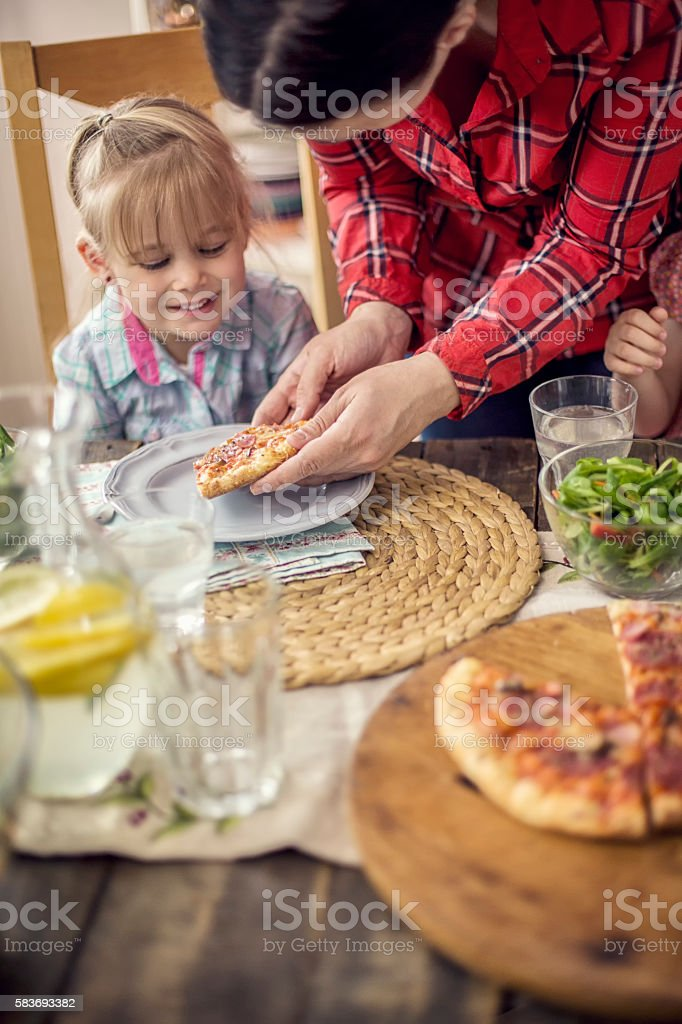 Eating Pizza with Fresh Salad stock photo