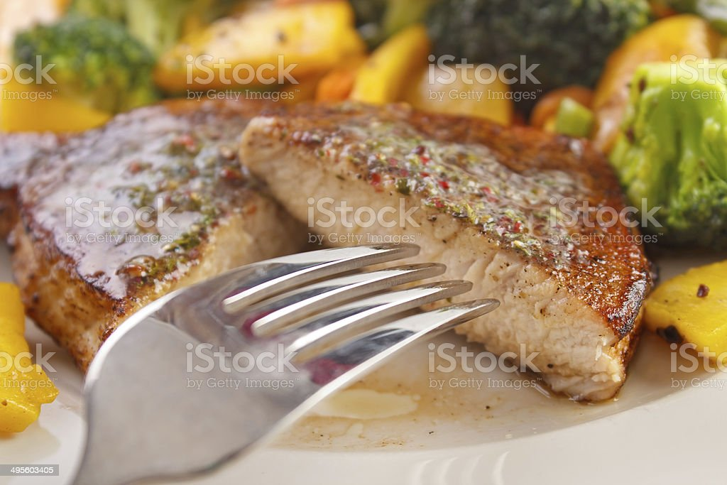 Eating pork steak royalty-free stock photo