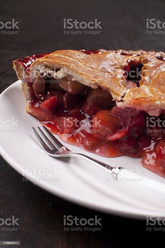 Eating rhubarb and strawberry tart stock photo