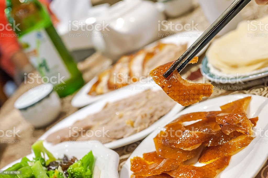 Eating roast duck at a Beijing roast duck restaurant stock photo