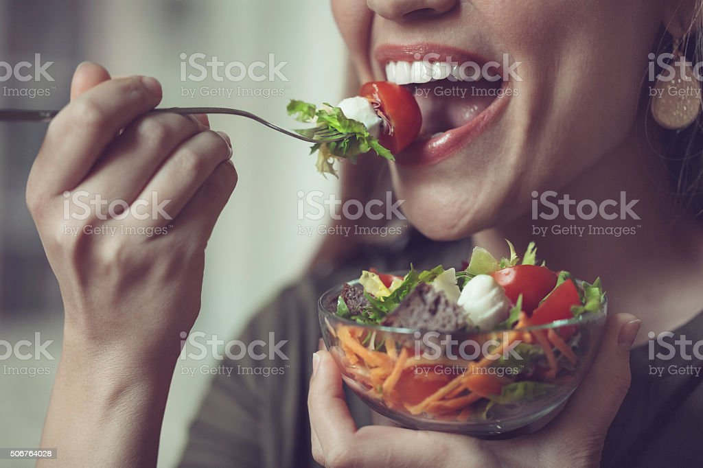 Eating salad stock photo