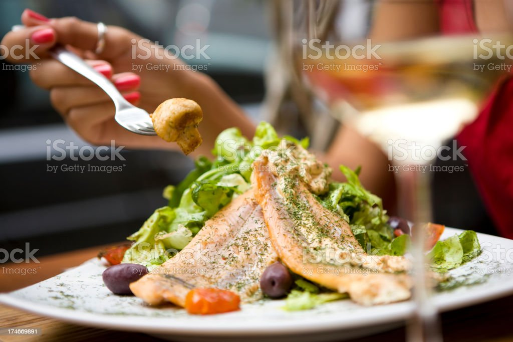 Eating salmon salad stock photo
