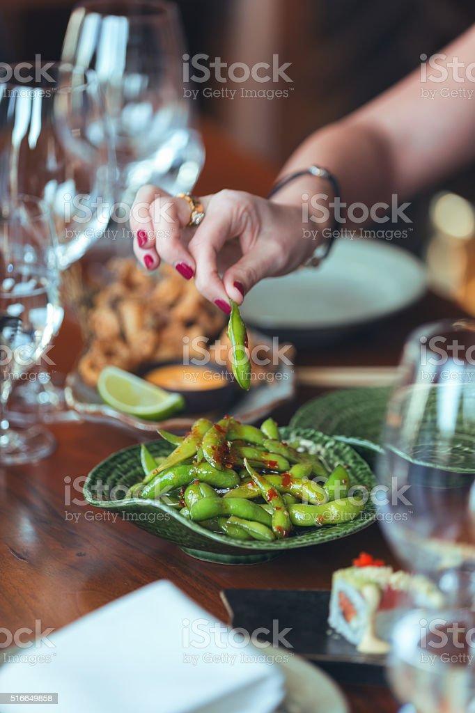 Eating soy bean stock photo