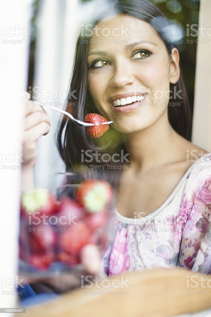 Eating strawberry royalty-free stock photo
