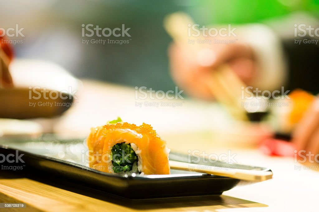 Eating Sushi Dinner. Japanese Cuisine. stock photo