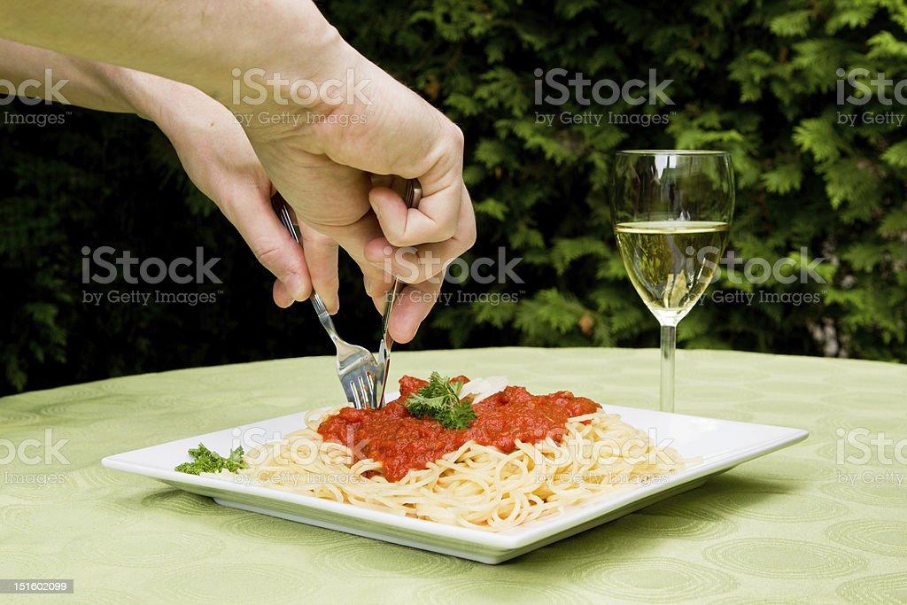 Eating tasty Italian pasta stock photo