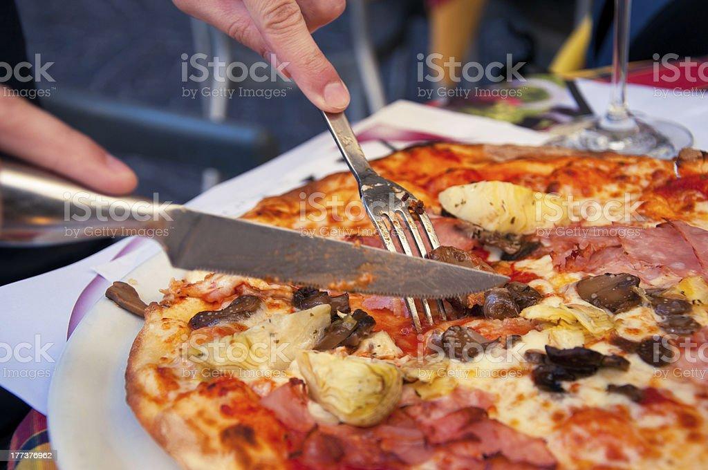 Eating tasty Italian pizza royalty-free stock photo