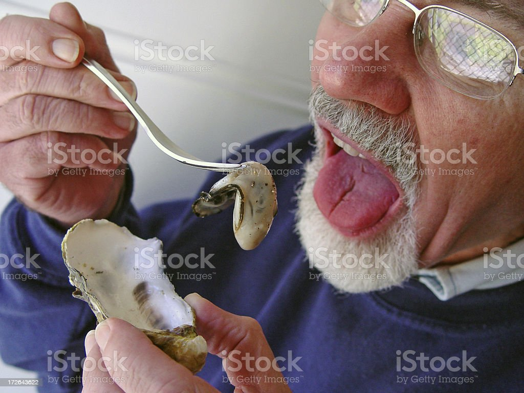 Eating the oyster stock photo