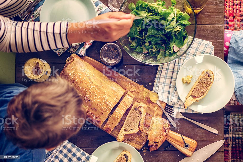 Eating Toad-in-a-Hole Meat Pie stock photo