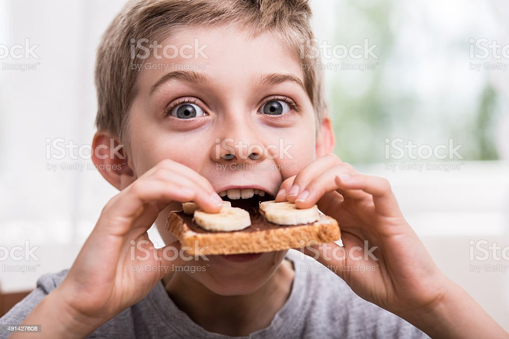 Eating toast with chocolate stock photo