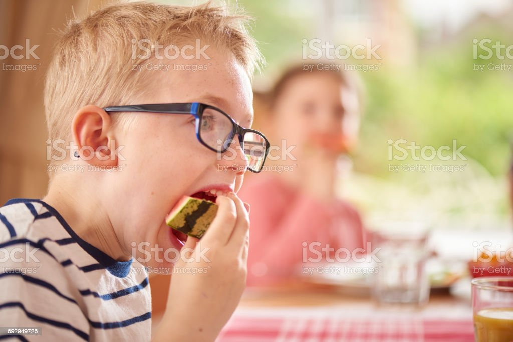 eating watermelon stock photo
