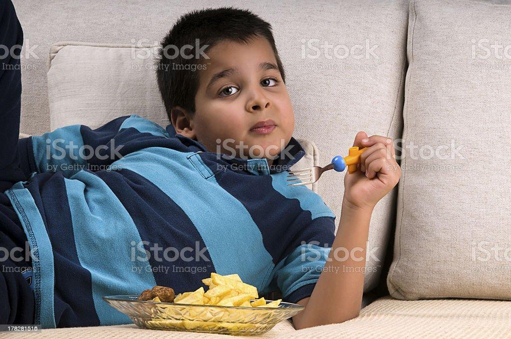 Eating while Lying royalty-free stock photo