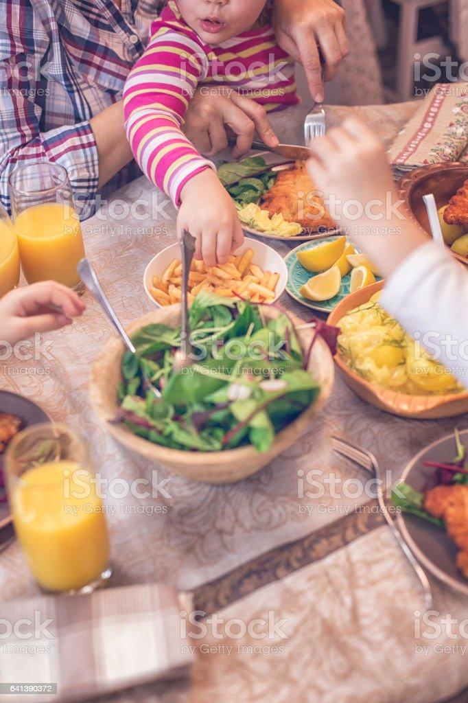 Eating Wiener Schnitzel stock photo