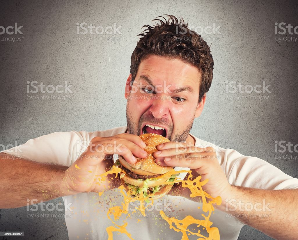 Eating with violent impetuosity stock photo