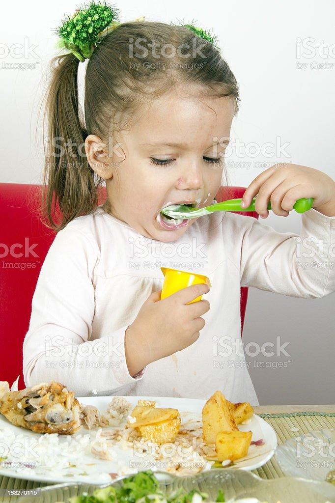 eating yoghurt royalty-free stock photo