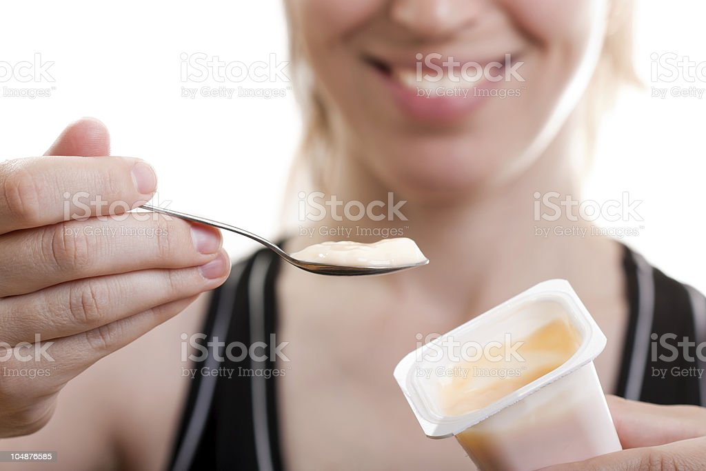 Eating yogurt royalty-free stock photo