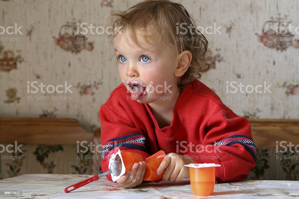 Eating yogurt royalty-free stock photo