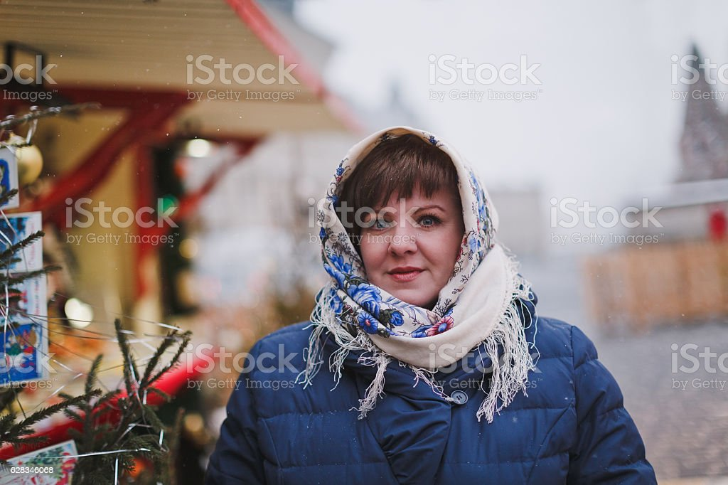 eautiful woman in a head scarf in the Russian style stock photo