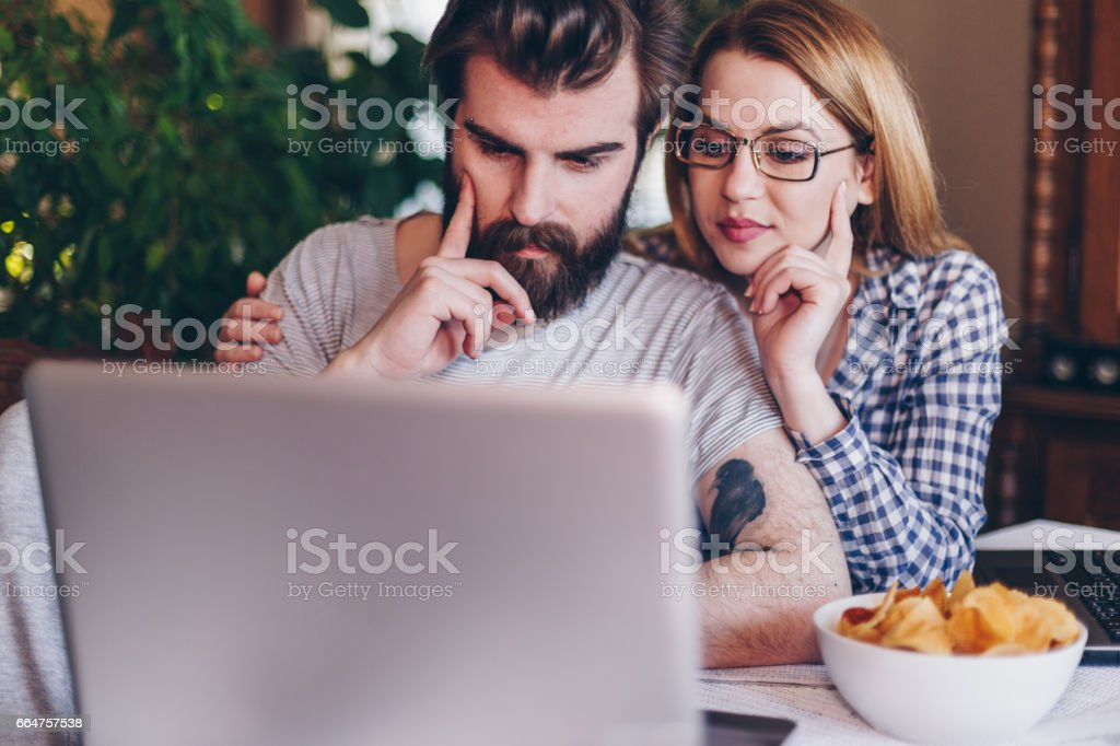 eautiful young people surfing the net to find solution stock photo