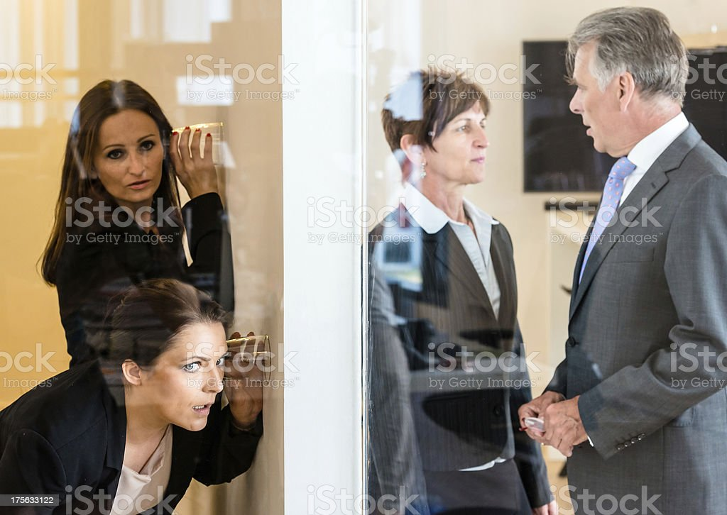 eavesdropping in the office royalty-free stock photo