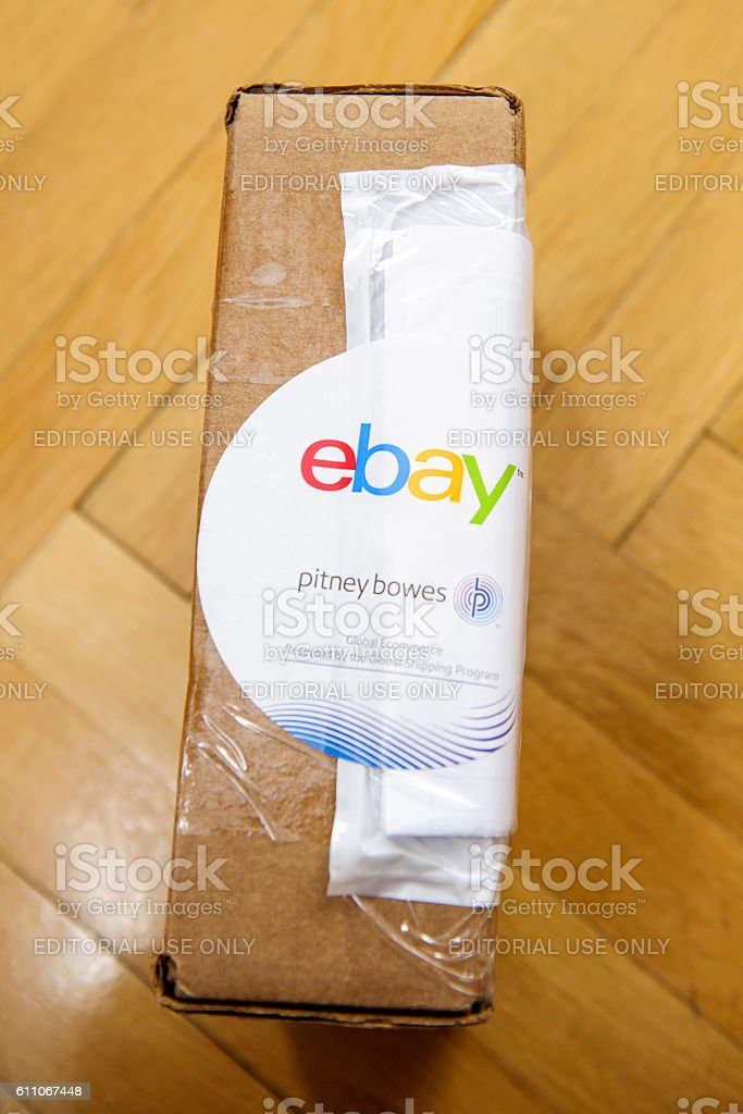 Ebay and Pitney Bowens logotype printed on cardboard box stock photo