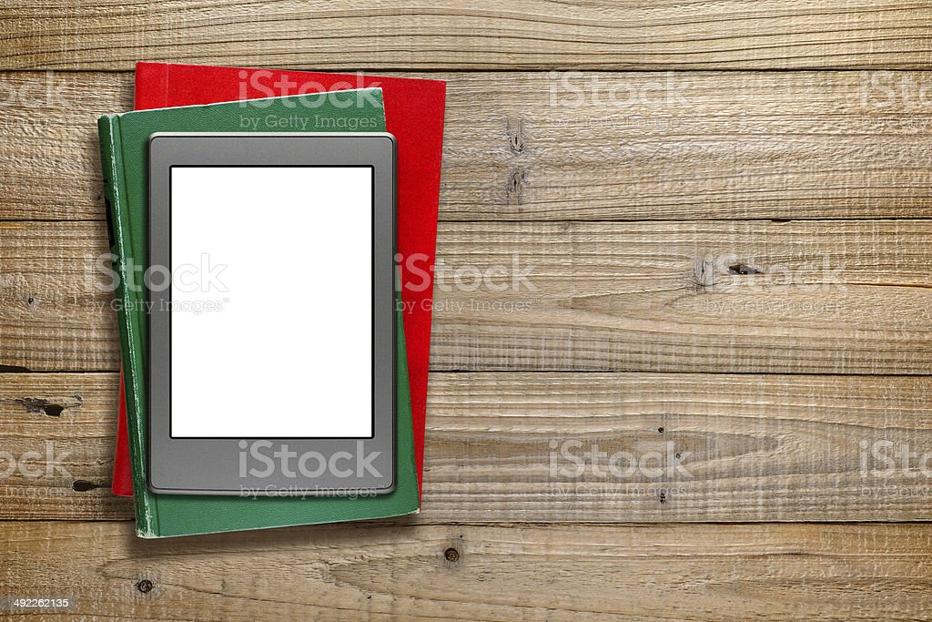 E-book reader and old books stock photo