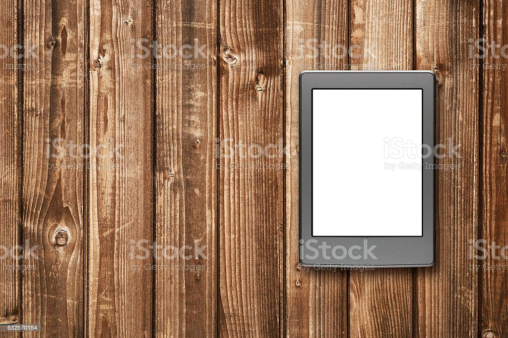 E-book reader on wooden background stock photo