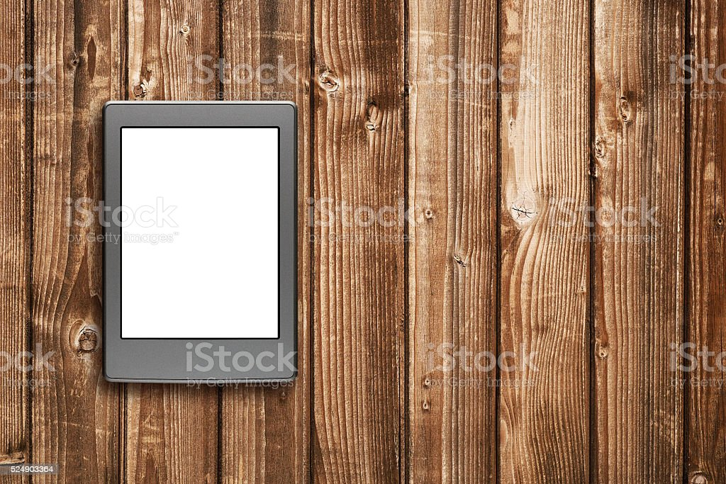 E-book reader on wooden table top view stock photo