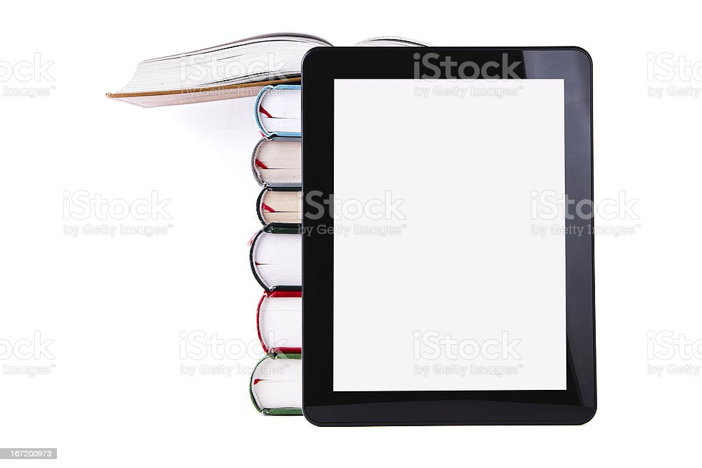 E-Book Reader:Digital Tablet and book stack stock photo