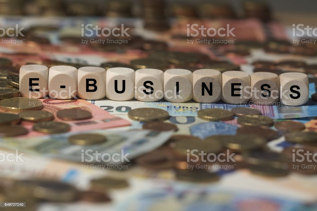 e-business - cube with letters, money sector terms - sign with wooden cubes stock photo