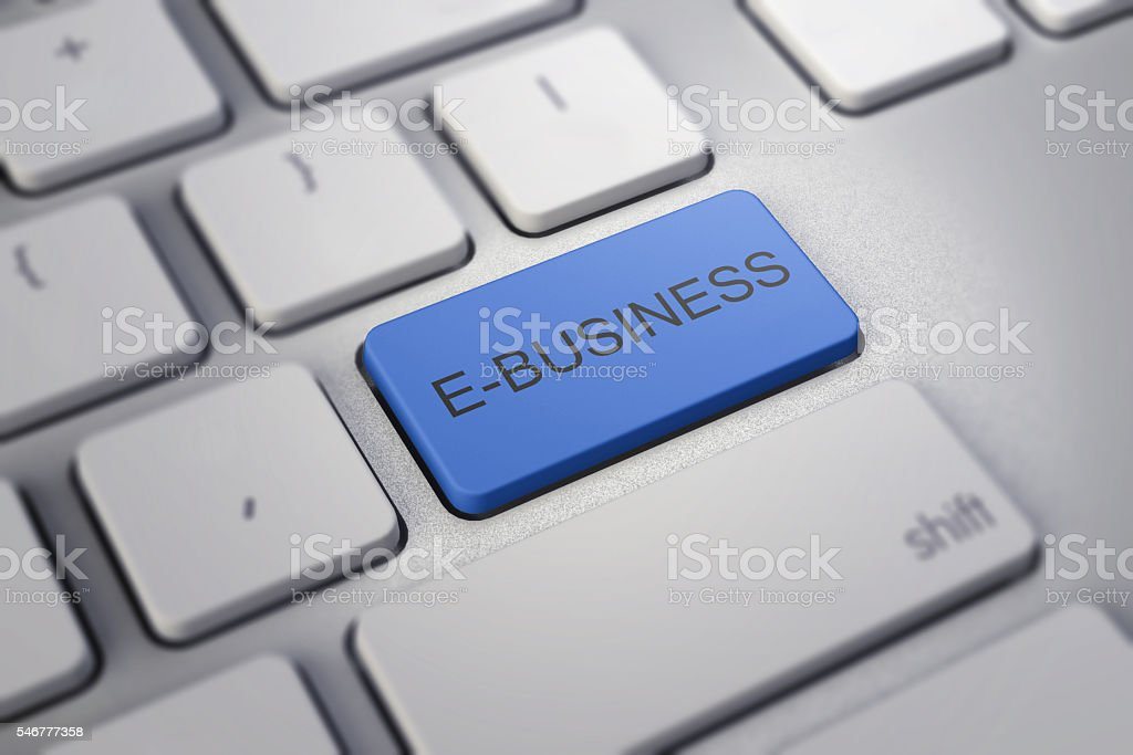 e-business key on white a keyboard closeup. -commerce concept image. stock photo