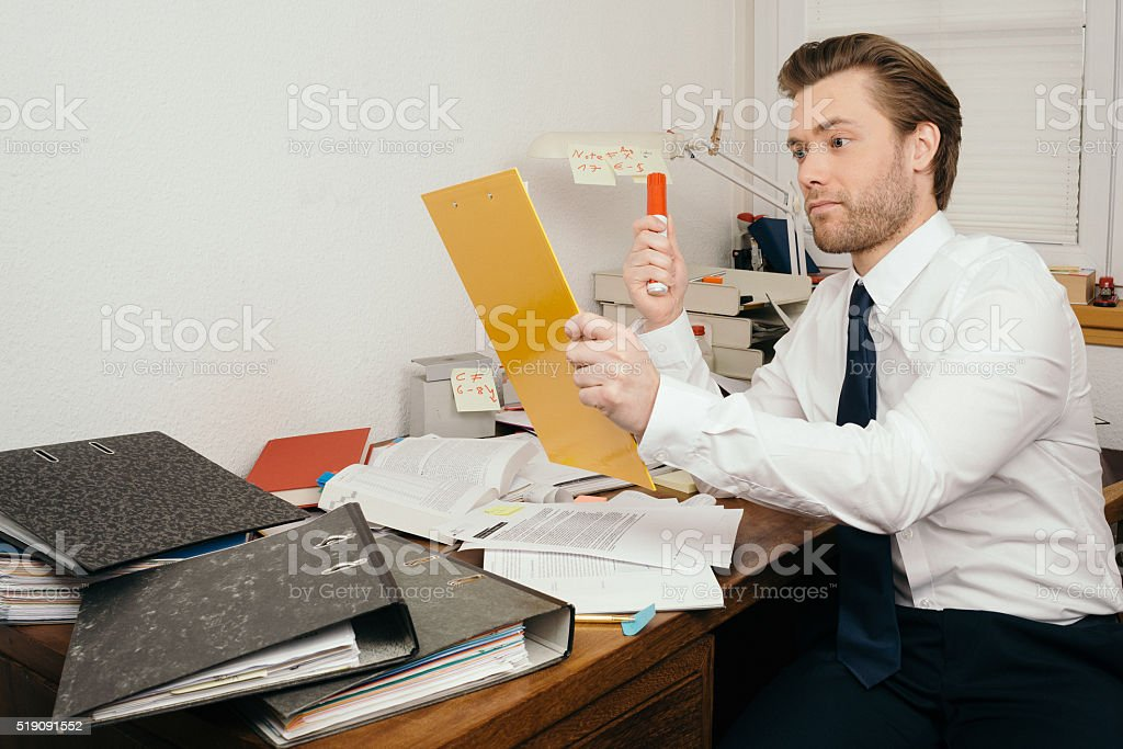 Eccentric Auditor in his Office stock photo