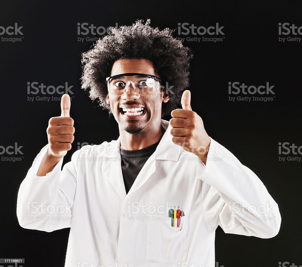 Eccentric scientist gives two approving thumbs up and grins stock photo
