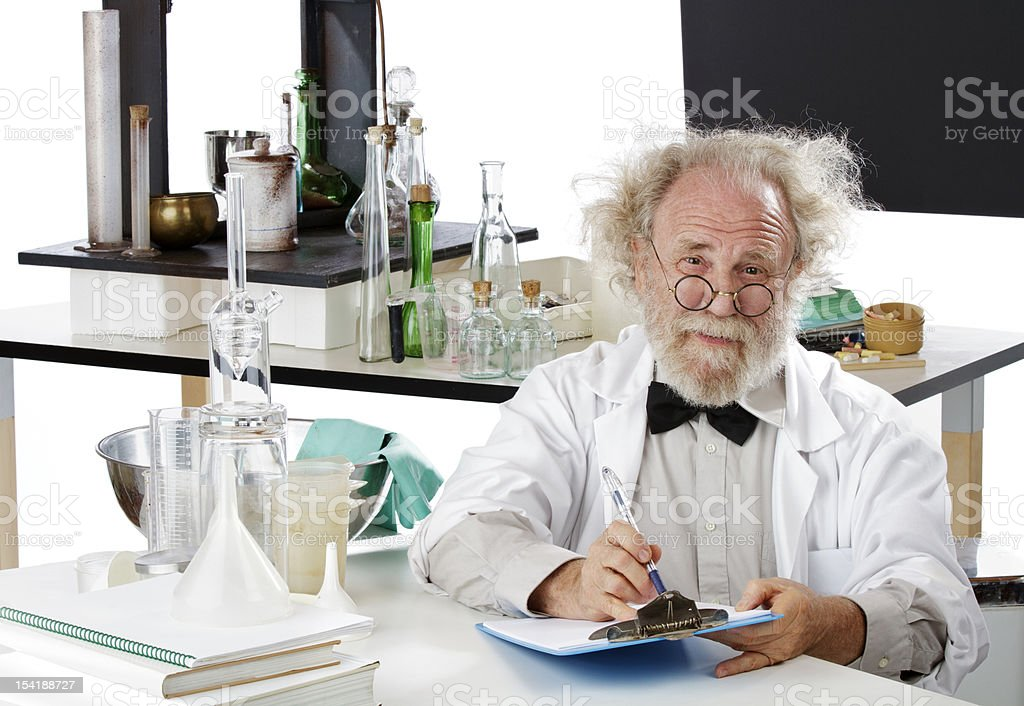 Eccentric scientist in lab holding pen and clipboard royalty-free stock photo
