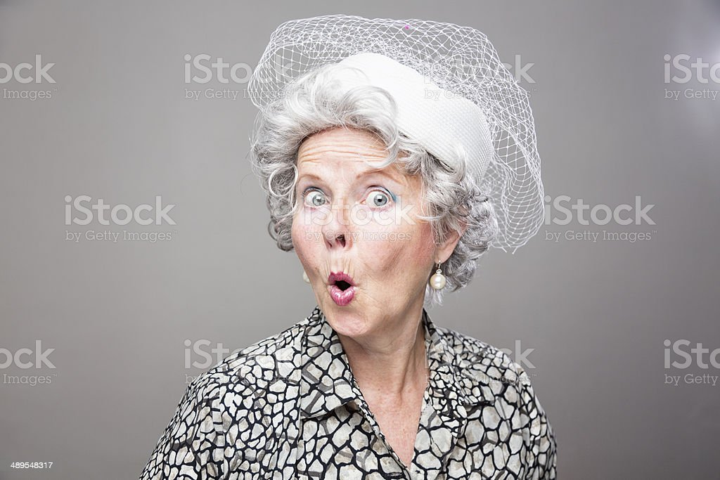 eccentric senior woman retro style surprise stock photo