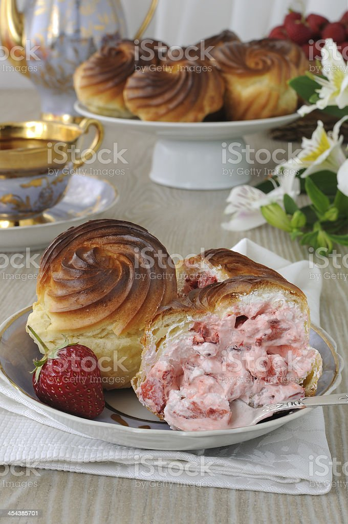 Eclairs with strawberry cream filling royalty-free stock photo