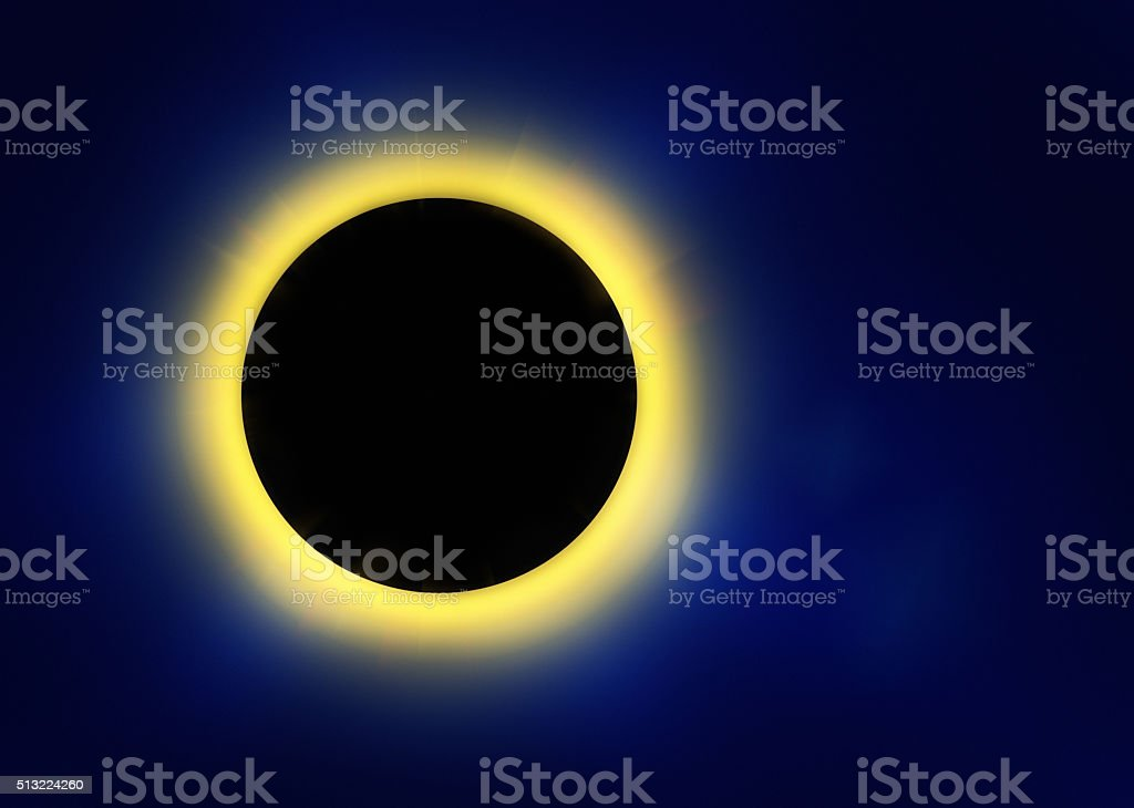 Eclipse effect: Golden light radiating behind black disc stock photo