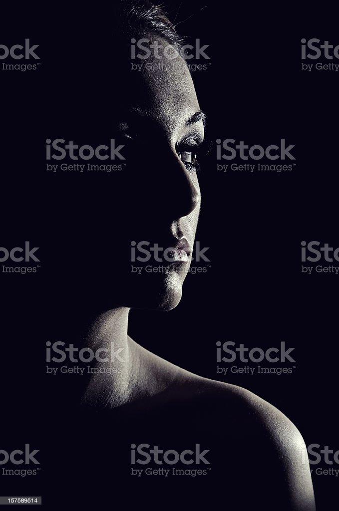 Eclipsed Female stock photo