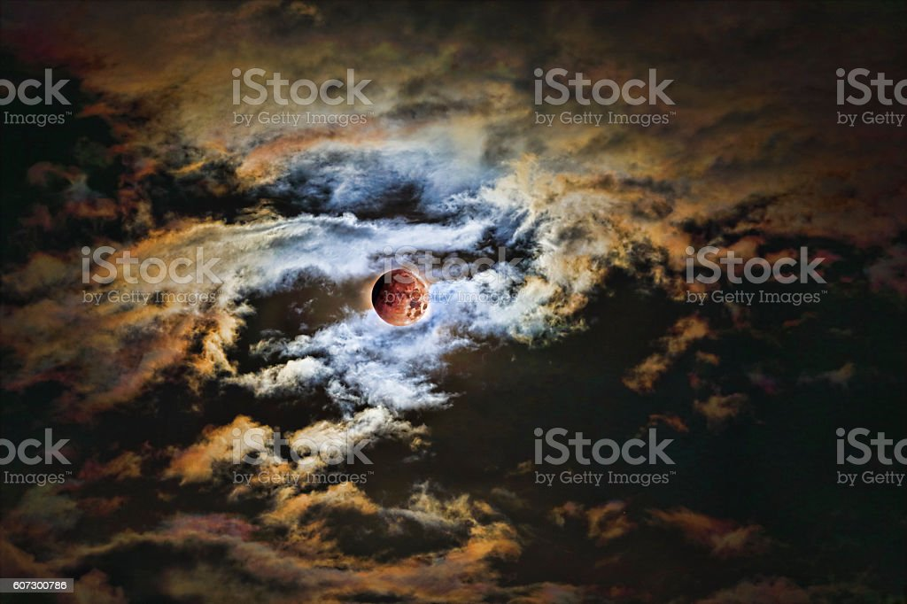Eclipsed Full Moon with Wispy Clouds stock photo